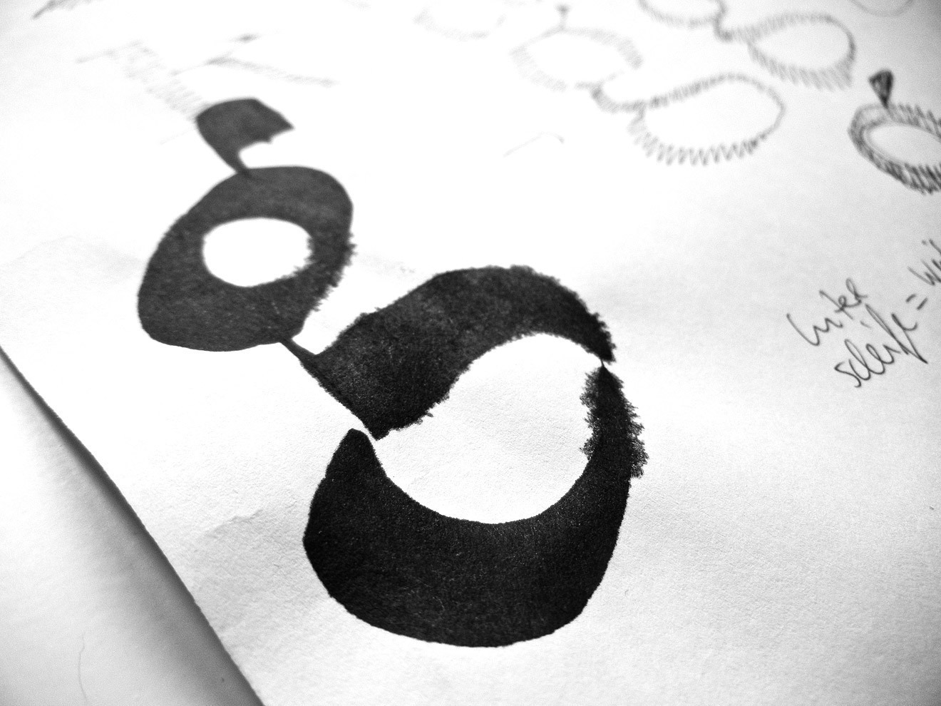 Unexpected inspiration: doodling in calligraphy class gives birth to the distinctively shaped lowercase 'g'.