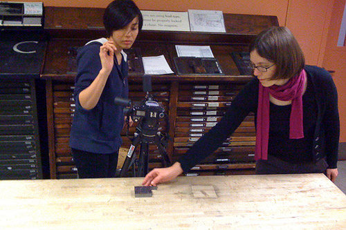 Lynn Kiang (left) and Sara Raffo composing shots in the RISD letterpress shop for the stop motion video Type High. Photo by Gregory Geiger