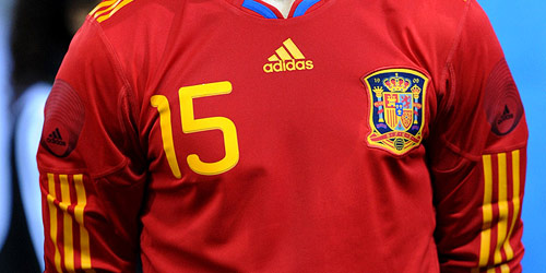 Unity numbers on a Spanish shirt.